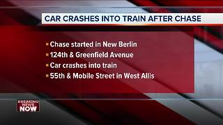 Driver fleeing police hits train in West Allis - Video
