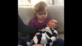 Toddler Big Sister Was Not Impressed With Her New Sibling