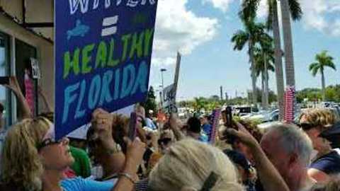Rick Scott Uses Back Door at Campaign Event as 'Red Tide' Protesters Block Entrance