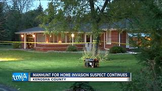 Suspect at large after two elderly people injured in Kenosha home invasion - Video