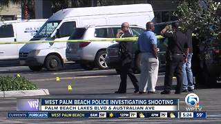 Gunman shoots at vehicle in Family Dollar parking lot in West Palm Beach - Video