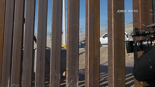 Migrants break through border fence - Video