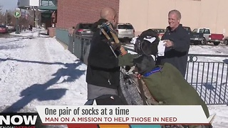 Man on mission to help those in need one pair of socks at a time - Video