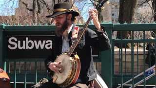 Busking Banjo Players Entertain Passersby Near New York Subway - Video