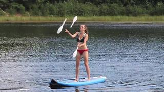 Acrobatic juggling act while on a stand up paddle board! - Video