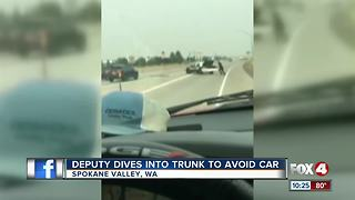 Deputy Dives Into Trunk to Avoid Car - Video