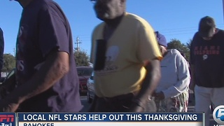 NFL stars help feed needy Pahokee families - Video