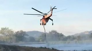 Firefighting Helicopters Refill Water Tanks near California Wildfires - Video