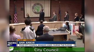 Four Ann Arbor city councilmembers take a knee during Pledge of Allegiance - Video