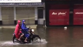 Motorbikes Speed Through Hue's Flooded Streets - Video