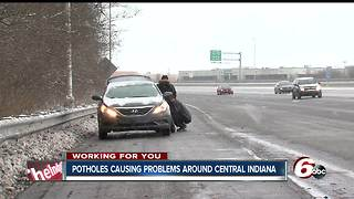 Potholes causing flat tires on I-465 - Video