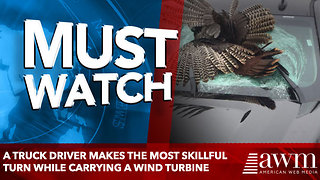 A truck driver makes the most skillful turn while carrying a wind turbine - Video