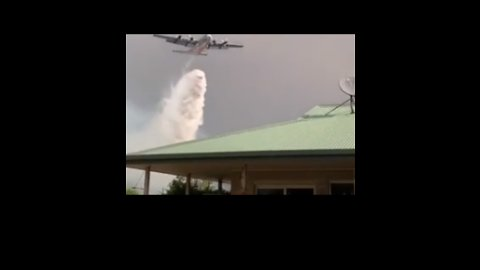 Waterbomber Drops Load Over Home as Blaze Threatens Property