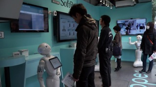 The Humanoid Robot Pepper Serves At A Cell Phone Shop In Tokyo, Japan - Video