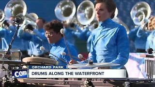 Drums along the waterfront rocks New Era Field