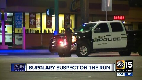Burglary suspect on the loose after hitting Tempe officer's car