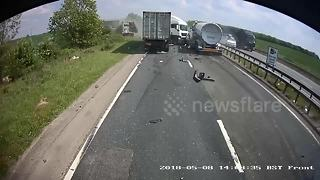 Shocking moment tanker ploughs into back of HGV on UK A-road - Video