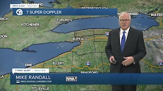 More seasonable temperatures and scattered snow showers
