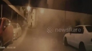 Dramatic dash-cam footage shows building collapse in front of cars - Video