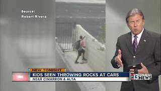 Kids seen throwing rocks at cars - Video