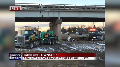 Semi truck hits overpass in Canton Township