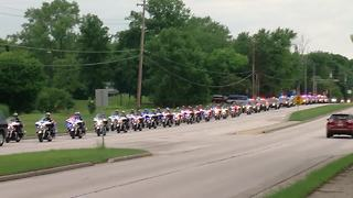Funeral procession for fallen officer arrives at Elmbrook Church in Brookfield for visitation, funeral