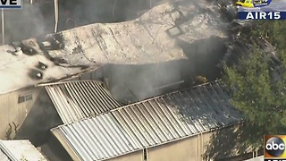 Fire crews on scene of Phoenix mobile home fire - Video
