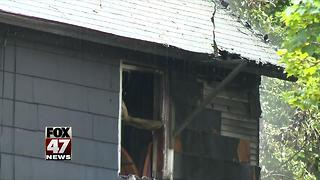 Crews battle house fire in Lansing - Video