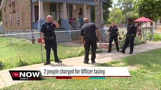 Two charged in tazing of DPD officer - Video