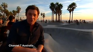 Errant skateboard hits reporter head on
