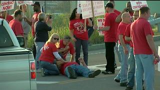 SUV crashes through picket line at DuPont plant - Video