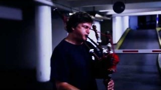 Bagpipe Music Echoes Around Carpark - Video