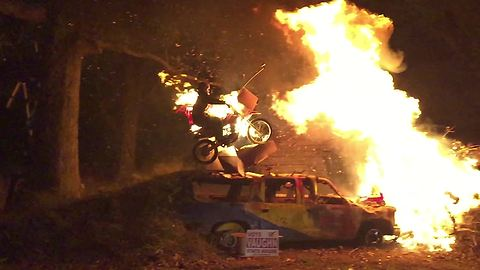 Insane bonfire dirt bike stunt captured in slow motion