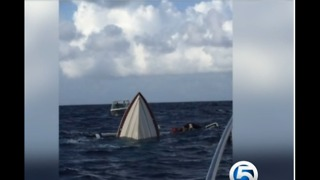 Family rescued after boat sinks during vacation - Video