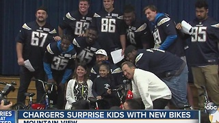Chargers surprise kids with new bikes