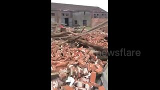 Nine injured as tornado tears through Chinese villages - Video