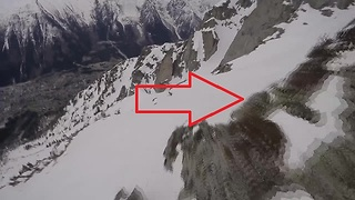 Wingsuit proximity flight comes inches to hitting cliff - Video