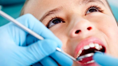 Father sneaks in on son's dentist cleaning.