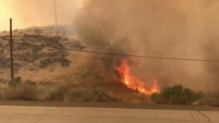 Car Passes Through Thick Smoke as Earthstone Fire Edges Onto I-80 Near Reno - Video