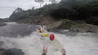 Kayaker catches football mid-air whilst riding 12ft waterfall - Video