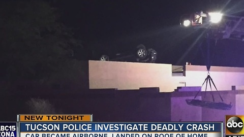 Tucson PD: 1 killed after car lands on top of home