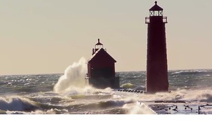 High Waves Lash Lighthouse on Lake Michigan - Video