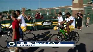 Kids line up early for Packers training camp bike ride - Video