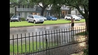 Man Paddles Down Flooded New Orleans Street