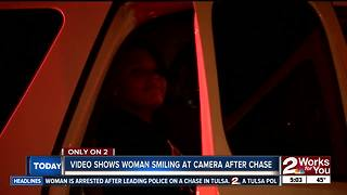 Woman smiling at camera after police chase - Video
