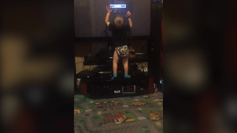 Tot Kid Plays With TV As It Were A Touch Screen Tablet