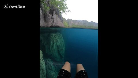 Guy Shoots Amazing Footage Of Rock Mountains In Crystal Clear Water
