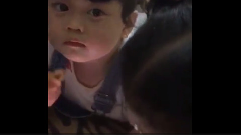 Cute little baby using tablet and eat