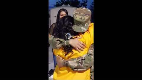 Soldier surprises younger sister at graduation ceremony