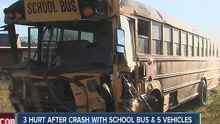3 hurt after crash with school bus